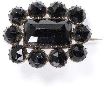 "An 1840s mourning brooch in ""French Jet"" or black glass. http://collections.vam.ac.uk/item/O120605/brooch-unknown/"
